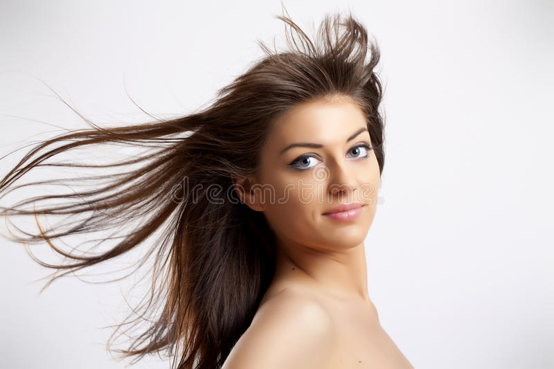 Woman with blown hair royalty free stock photography