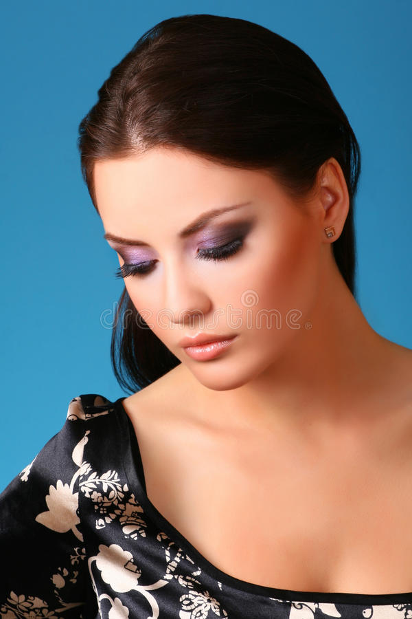 Woman On Blue Stock Images