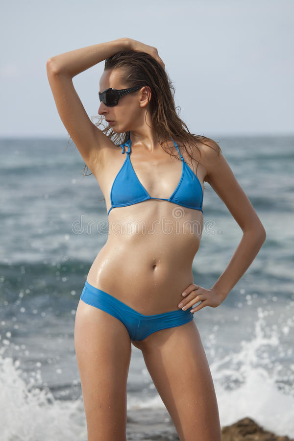 Woman In Blue Bikinis Stock Photo