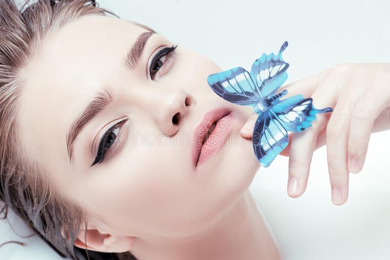 Woman with blue butterfly royalty free stock photo
