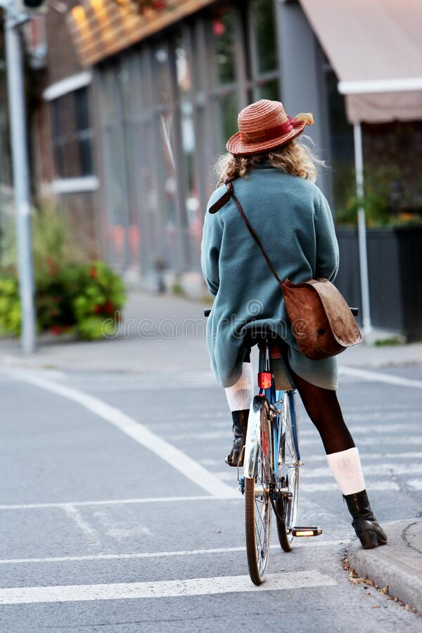Woman In Blue Coat Wearing Pink Straw Hat Riding Road Bicycle On Gray Concrete Street Road During Daytime Free Public Domain Cc0 Image