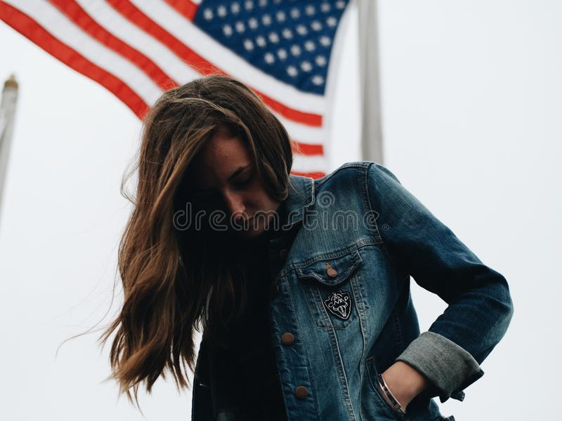 Woman In Blue Denim Jacket Behind U.s.a Flag During Daytime Free Public Domain Cc0 Image