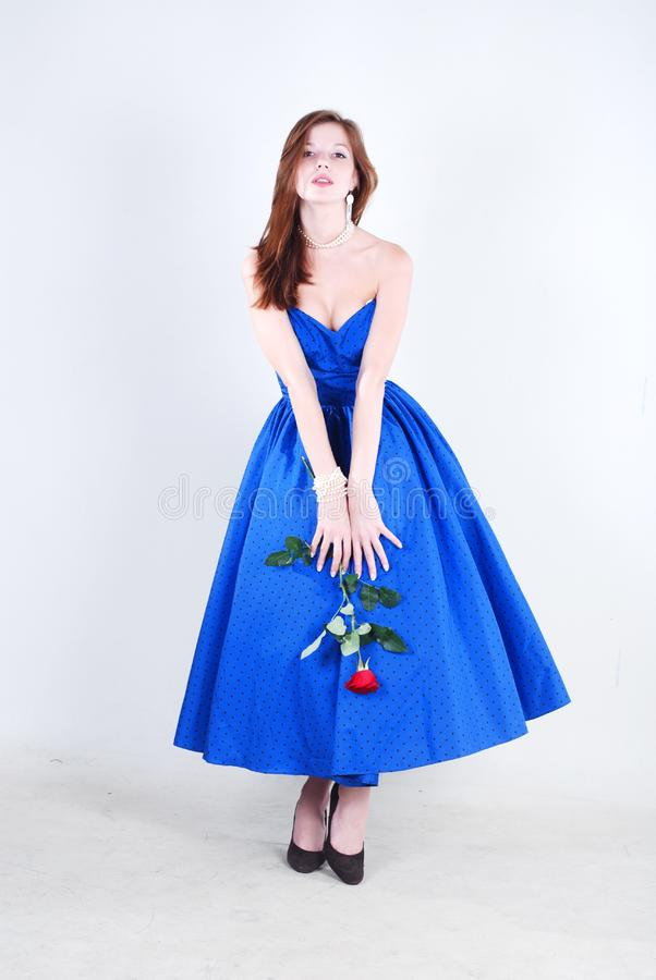 Woman in blue dress stock photography
