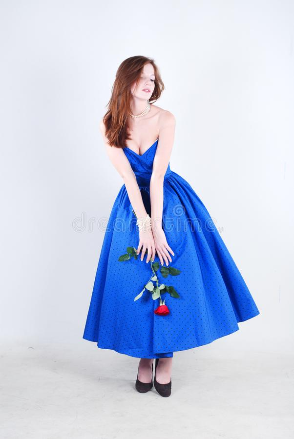 Woman in blue dress stock images