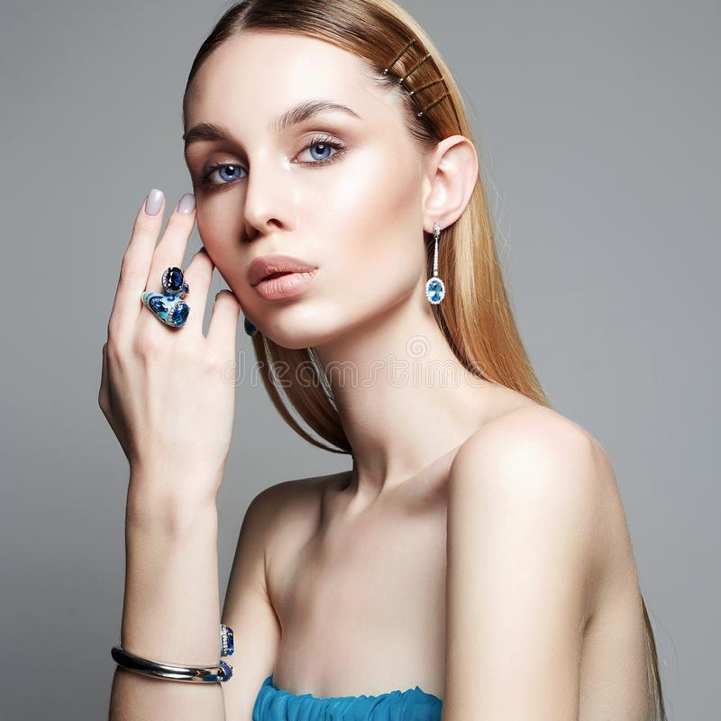 Woman in blue dress and jewellery. jewelry on beautiful girl stock images