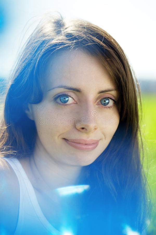 Woman With Blue Eyes With Sunflowers Royalty Free Stock Image