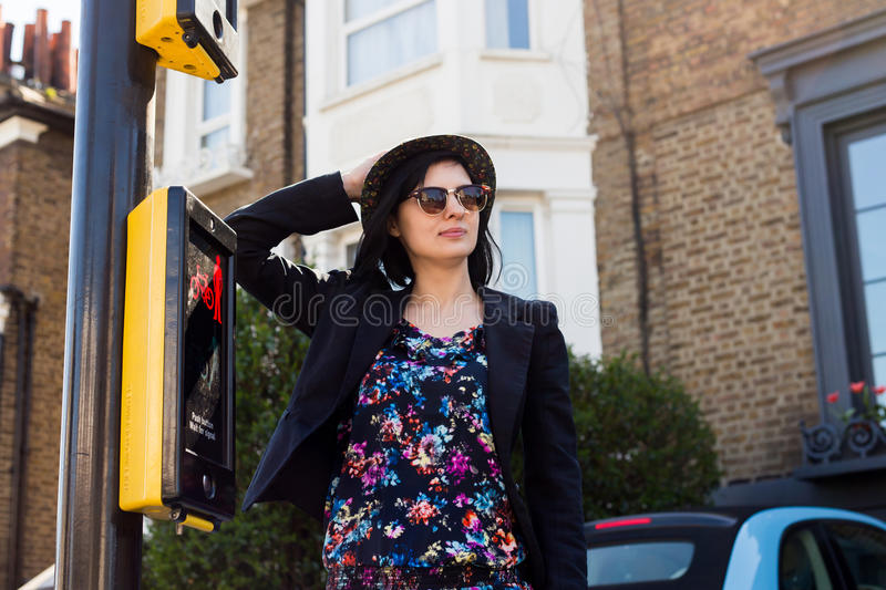 Woman in blue flowered dress, sunglasses and hat stock photos