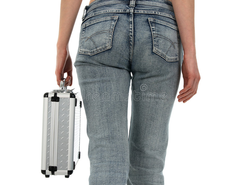 Woman in blue jeans with metal case stock photography