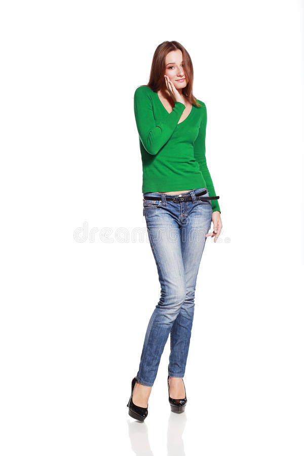 Woman in blue jeans posing stock photography