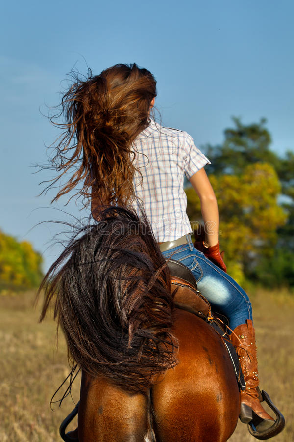 Download Woman In Blue Jeans Riding A Horse Stock Photo - Image: 28638780