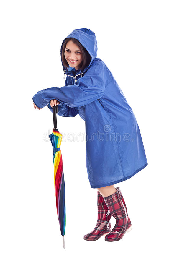 Woman in a blue mac. With umbrella stock images
