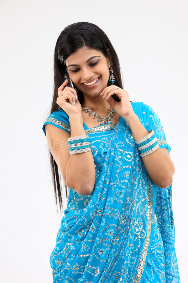 Woman in blue sari with mobile stock images