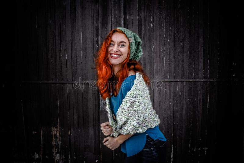 Woman in Blue Shirt an White Scarf With Red Hair royalty free stock photos