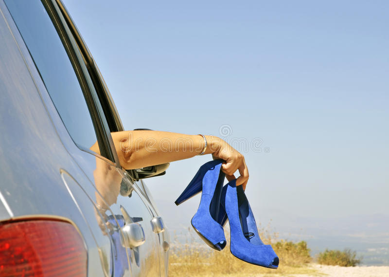 Woman With Blue Shoes In Hand Stock Photography