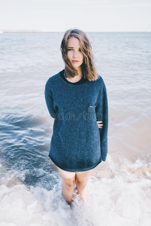 Woman In Blue Sweater Standing On Sea Shore During Daytime Free Public Domain Cc0 Image