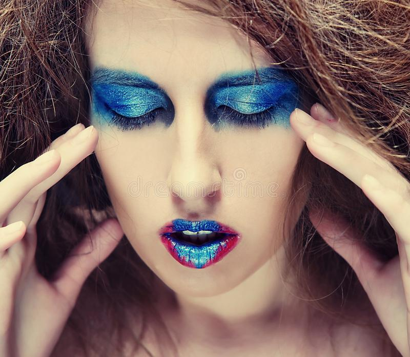 Woman with blue visage stock images