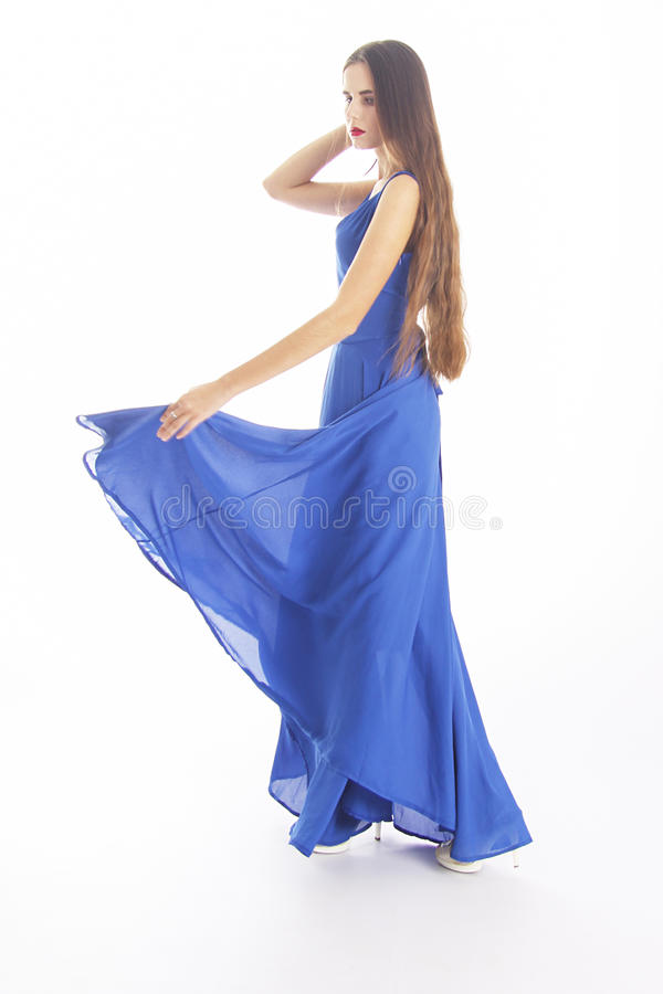 Woman in blue on white stock image