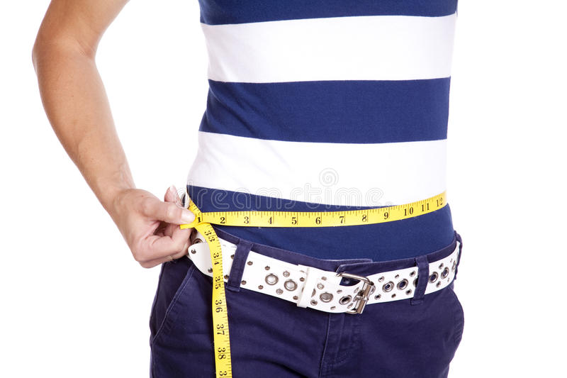 Woman in blue and white measuring waist stock image