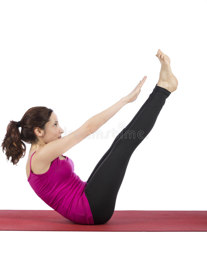 Woman in Boat pose in yoga stock photography