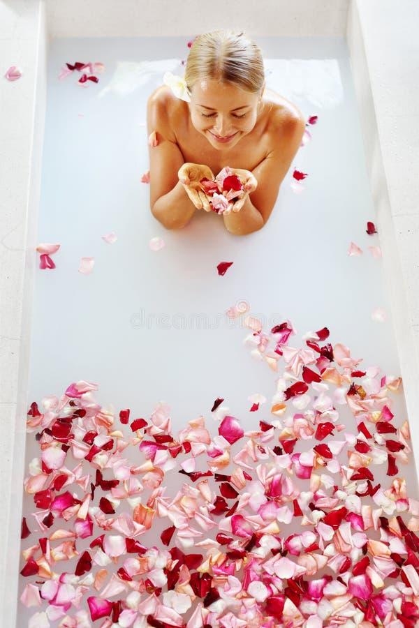 Woman Body Care. Spa Rose Flower Bath Treatment, Aromatherapy. stock photo