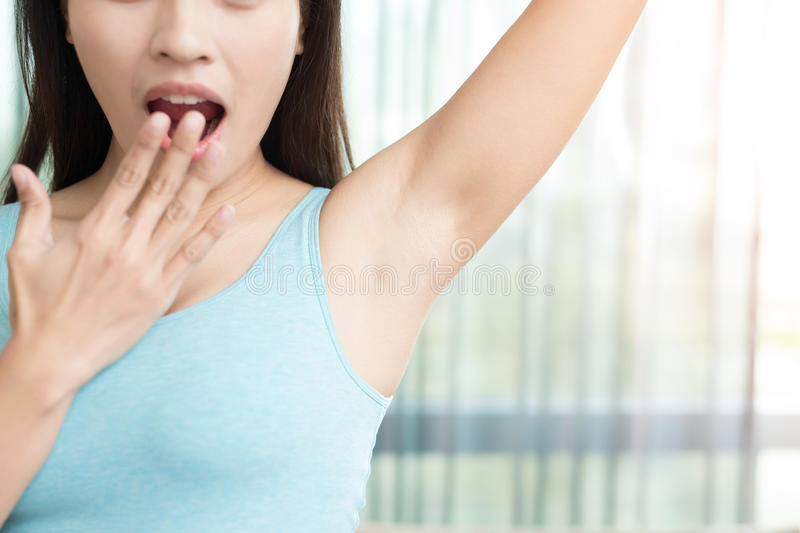 Woman with body odor royalty free stock photos