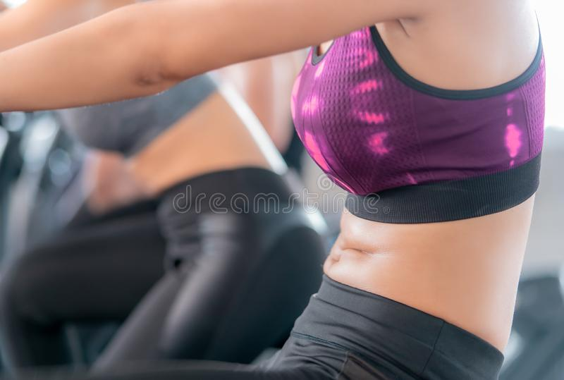 Woman body sweating while they exercising on Fitness Cyling Machine stock images