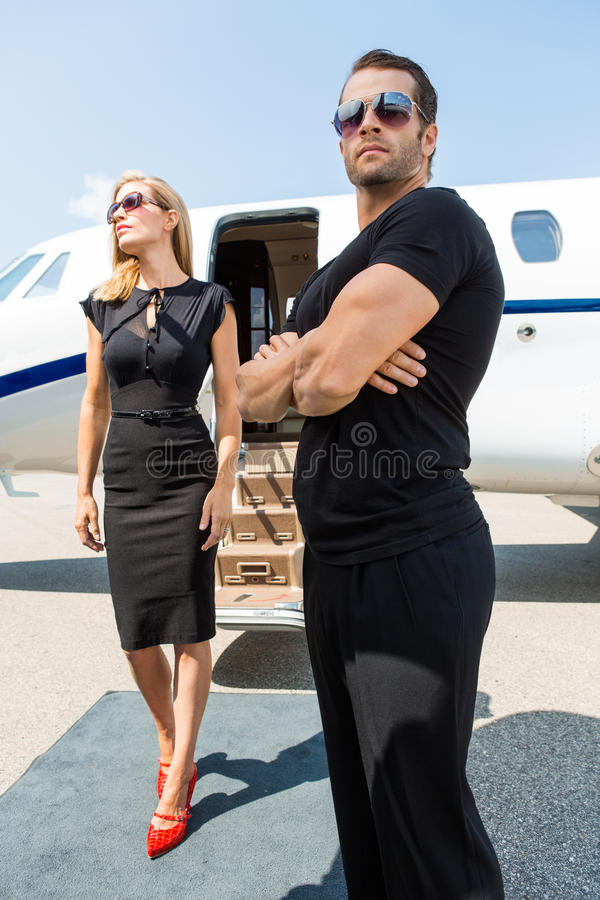 Download Woman With Bodyguard Against Private Jet Stock Image - Image: 36686581
