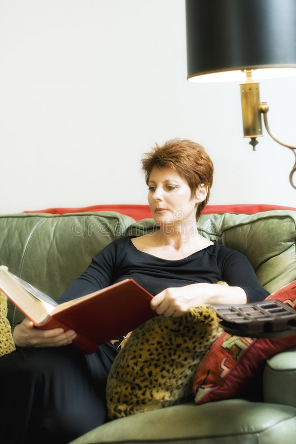Download Woman with a book stock photo. Image of couch, person - 6091210
