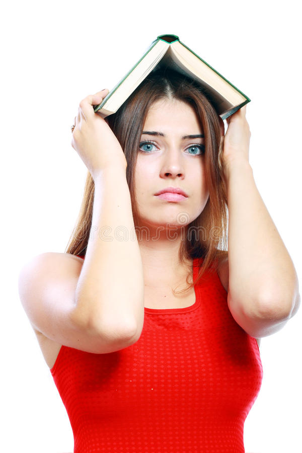 Woman With Book On Her Head Stock Images