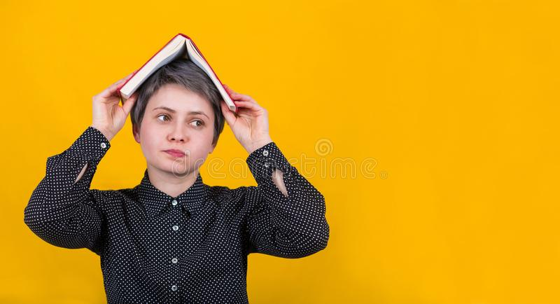 Woman book over head stock images