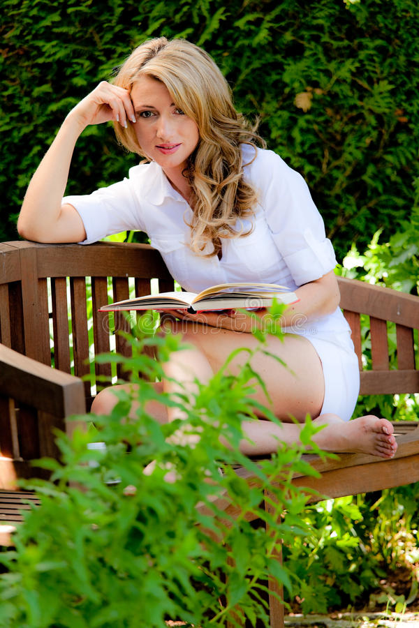 Download Woman At Book Reading In The Garden Stock Image - Image: 18723777