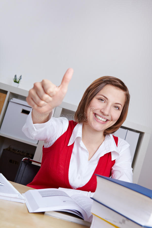 Download Woman With Books Holding Thumbs Up Stock Image - Image: 25119687