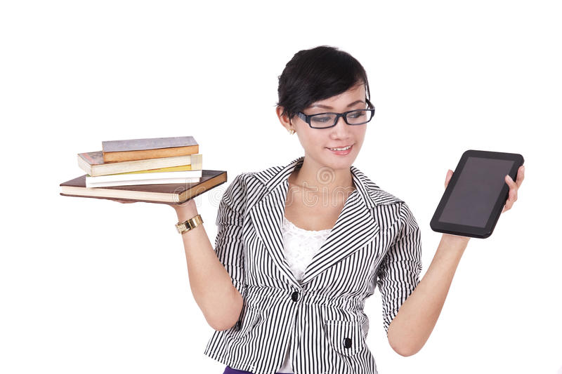 Download Woman with books and iPad stock photo. Image of pile - 24285340