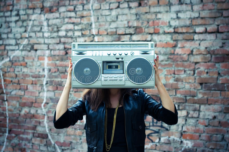 Woman with boom box head. Fashion woman with boom box head. Outdoor portrait stock images