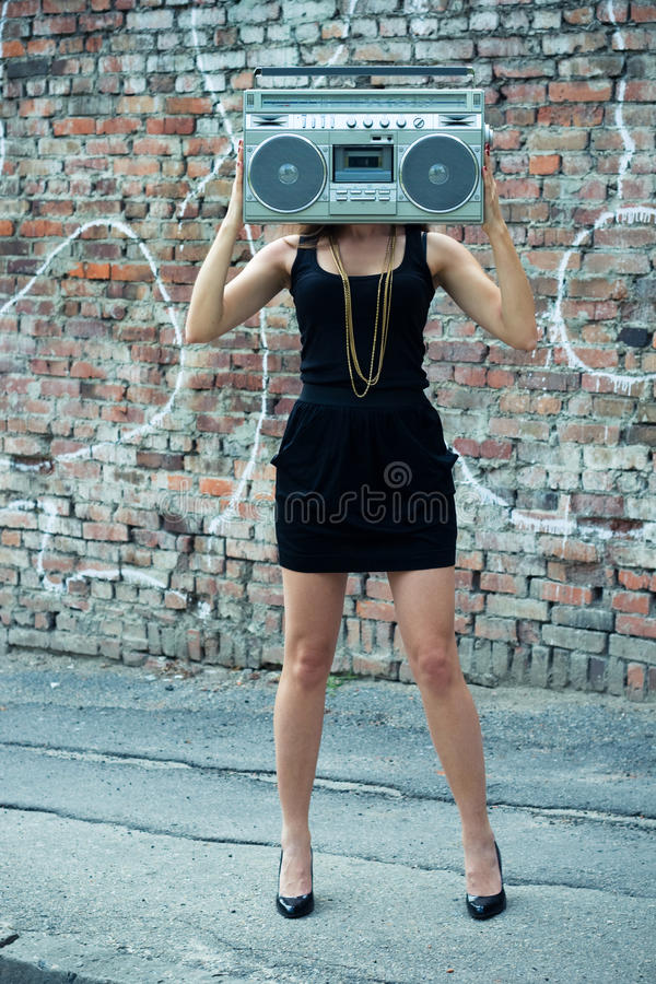 Woman with boom box head. Outdoors royalty free stock images