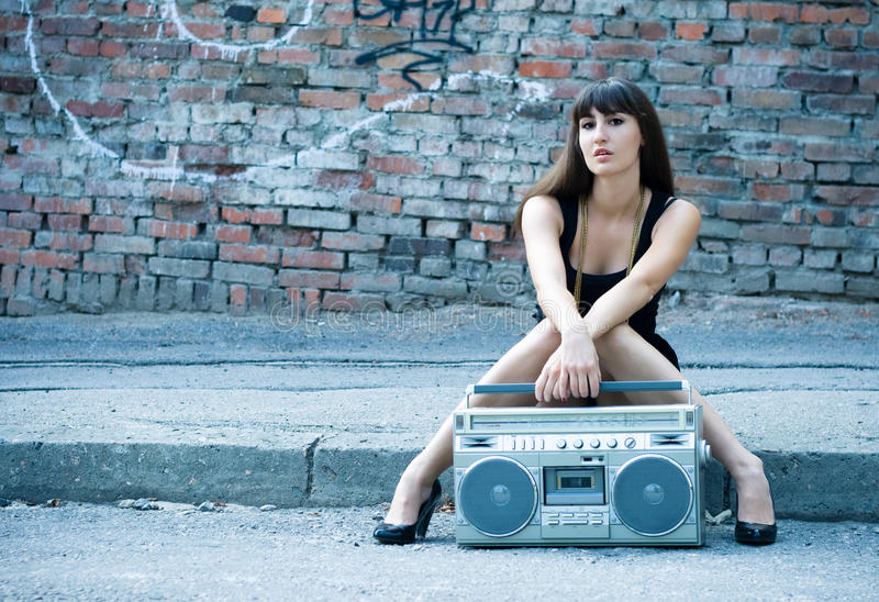 Woman with boom box on the street. Beautiful woman with boom box on the street stock image