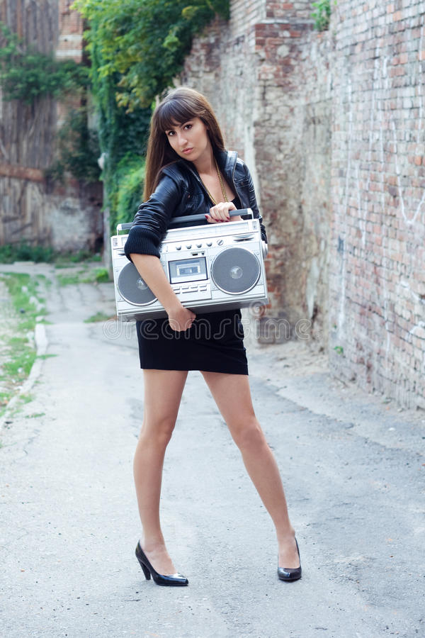 Woman with boom box on the street. Beautiful woman with boom box on the street stock images