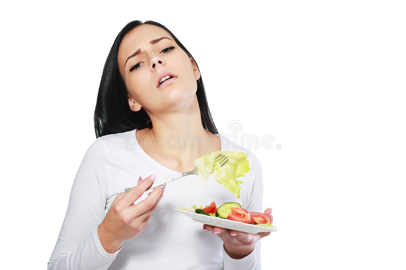 Woman boring to eat salad stock photos