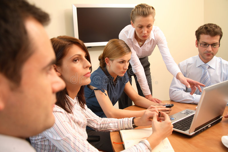 Woman boss in business. Group of five business people working together on project - three women and two men stock photography