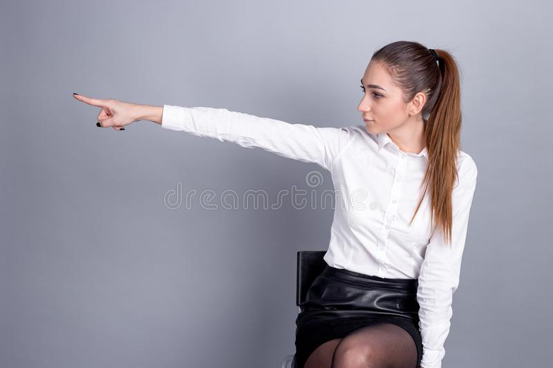 Woman boss in business. instructions at work. the girl is showing a finger. Workplaces stock image
