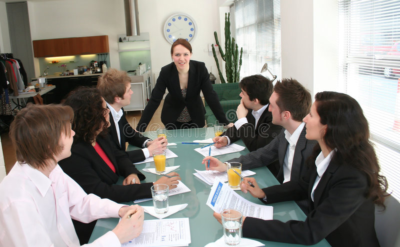 Woman Boss - Female Executive Leadership. Image of a woman looking into camera during a business meeting, young urban workers stock image