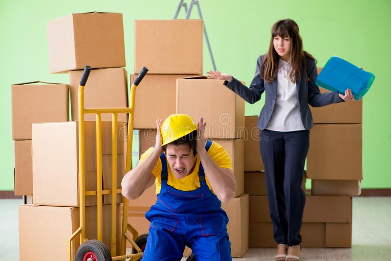 The woman boss and man contractor working with boxes delivery royalty free stock images