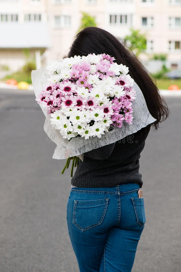 woman with bouquet of flowers stock photos