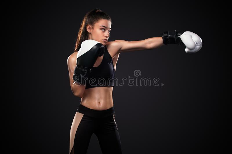 Woman boxer in boxing gloves on black background. Boxing and fitness concept. Street fighter fighting in boxing gloves. Isolated on black background with copy royalty free stock photos