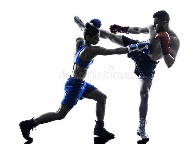 Woman boxer boxing man kickboxing silhouette isolated royalty free stock image