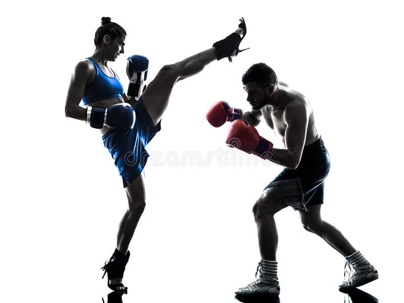 Woman boxer boxing man kickboxing silhouette isolated stock image