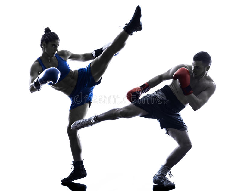 Woman boxer boxing man kickboxing silhouette. One woman boxer boxing one man kickboxing in silhouette isolated on white background stock photography