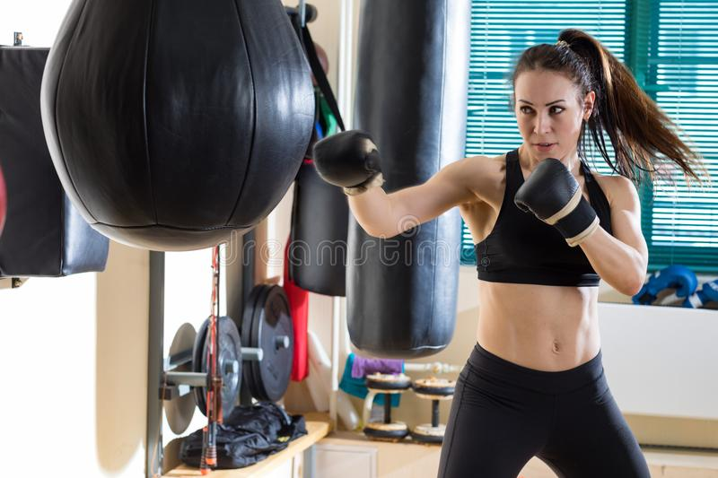 Woman boxer in time of workout royalty free stock image