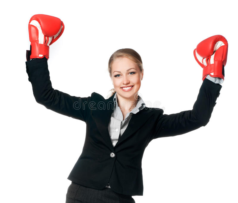 Woman with boxing gloves. Beautiful young woman with boxing gloves on white background stock images
