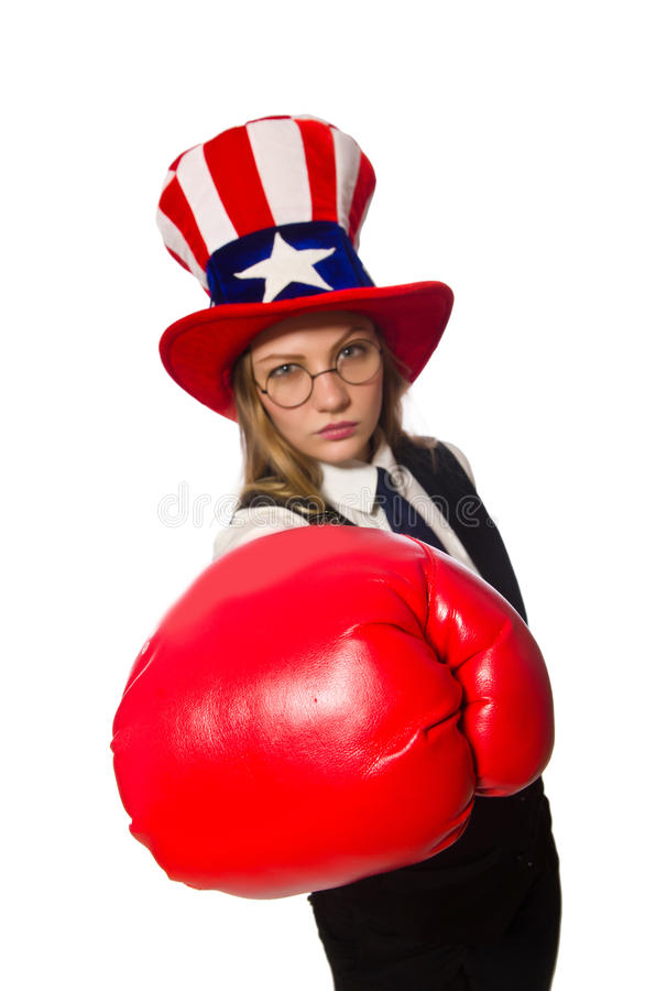 Woman with boxing gloves isolated on white. The woman with boxing gloves isolated on white stock photography